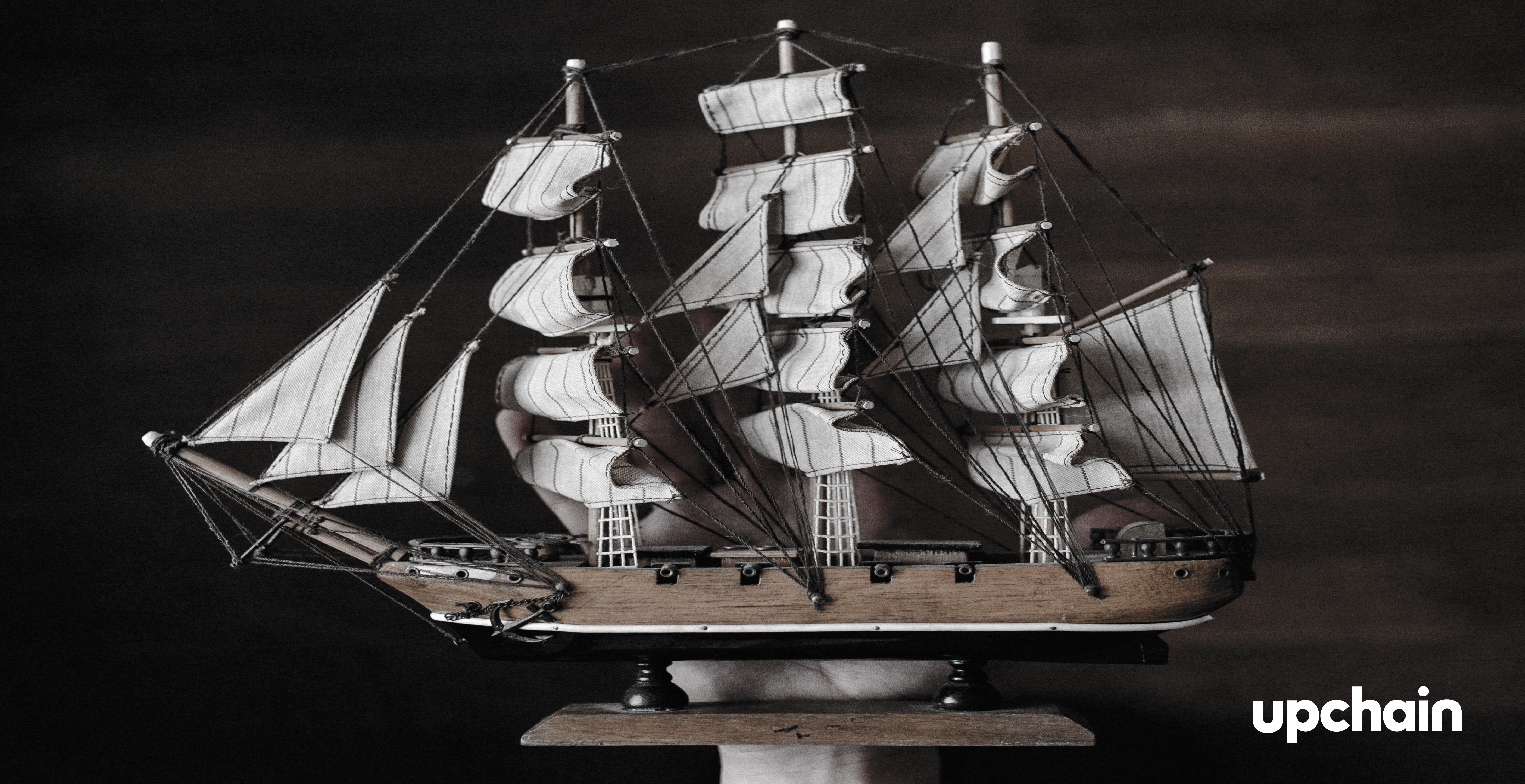 Model ship help up by a hand
