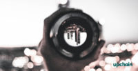 camera lens capturing city skyline