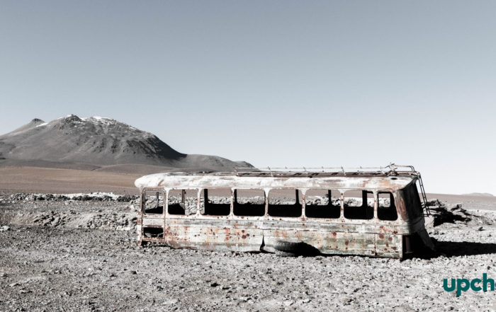 rusted bus in desert