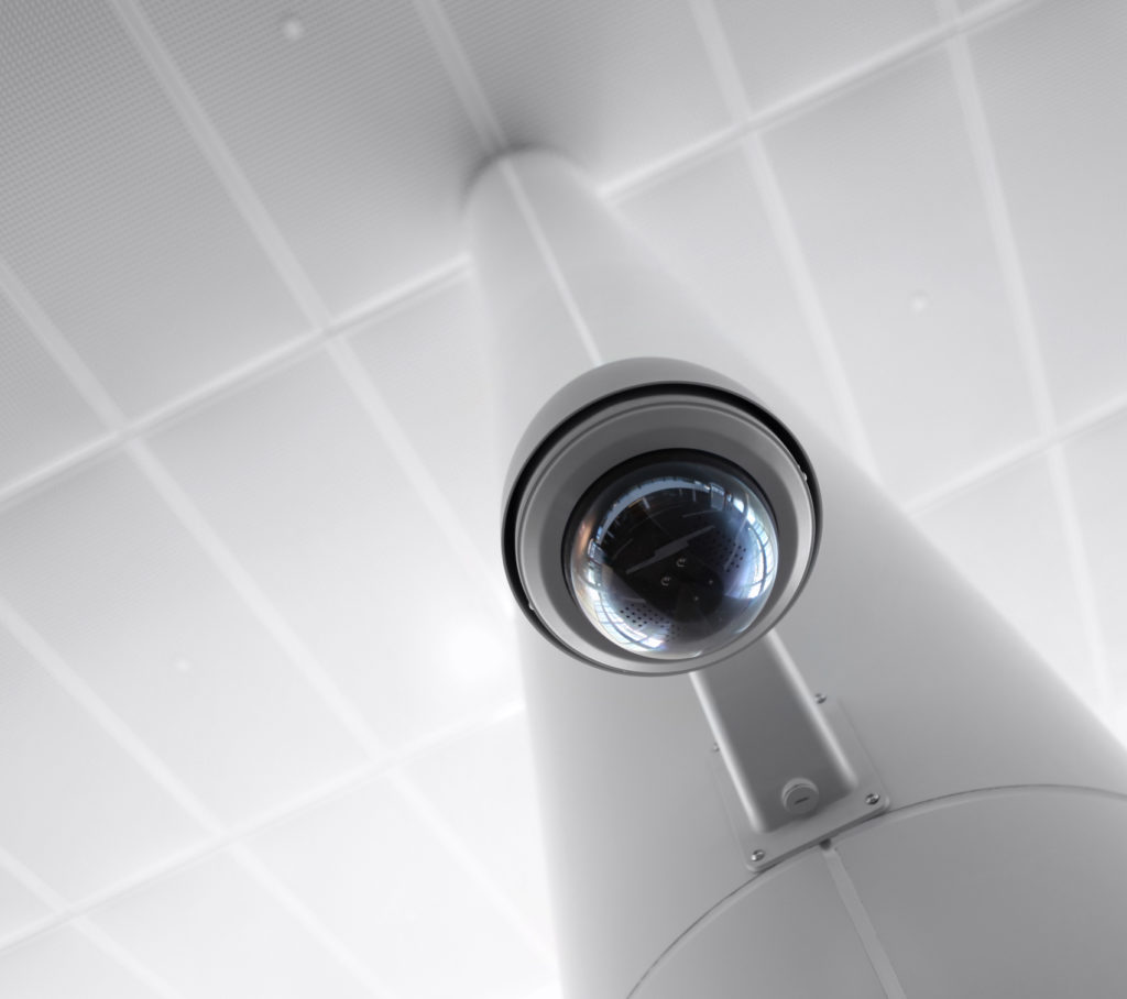 security camera on white pole