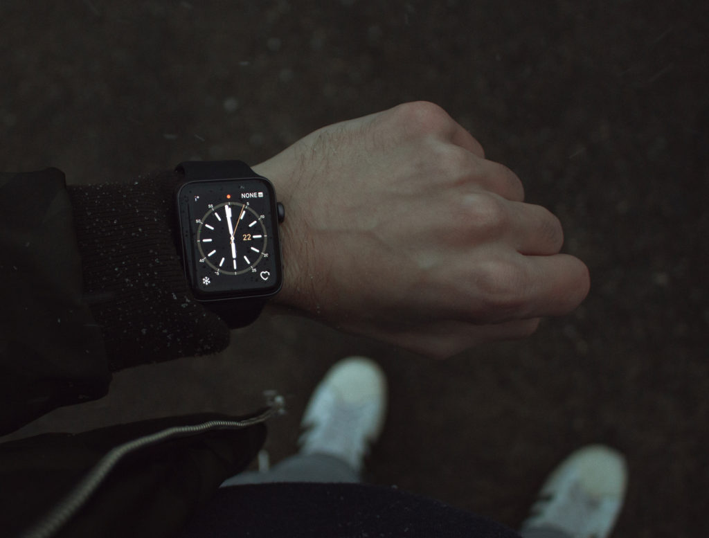 black smart watch on man's wrist