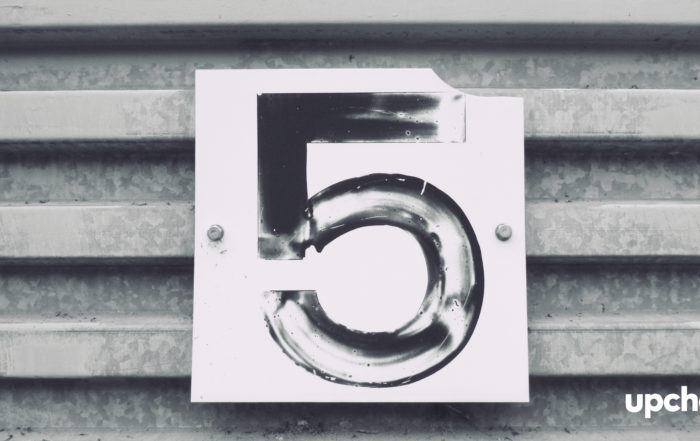 number five painted on garage